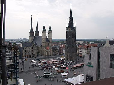 "Market Church with four towers and a single tower (""Red Tower"") in the city centre"